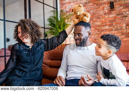 Happy Family With One Kid Playing At Home