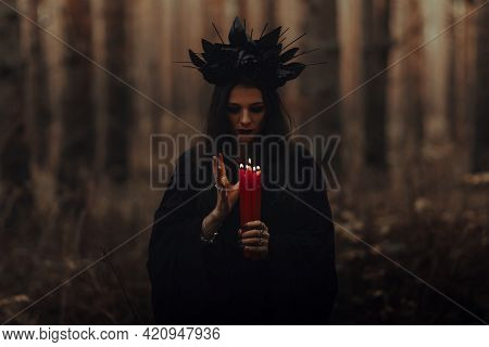Frightening Witch Performs An Occult Ritual With Candles