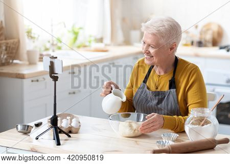 Senior Woman Food Vlogger Broadcasting While Cooking