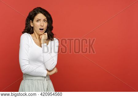 Scared Woman With Mouth Open In Shock, Stress, Disgust, Afraid With Folded Hands And Chin On Fist Ov