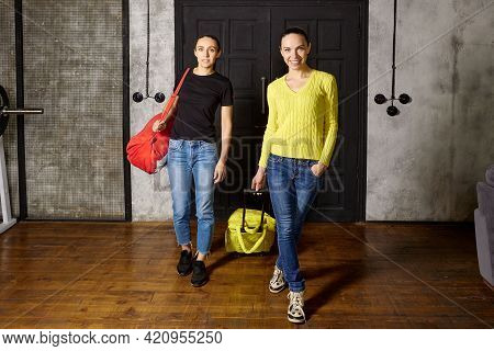 Entering At Home After Vacation, Caucasian Women Returned To Their Apartment From Travel.