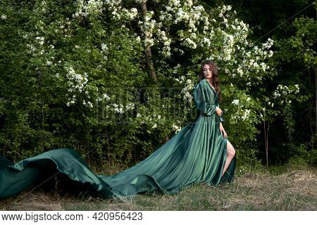 Russia, Naberezhnye Chelny, May 15, 2021: A Gentle Image Of A Young Woman In A Silk Green Dress With