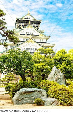 Beautiful Osaka Castle In Japan On Sunny Summer Day. Famous Castle, Attraction For Tourists And Sigh