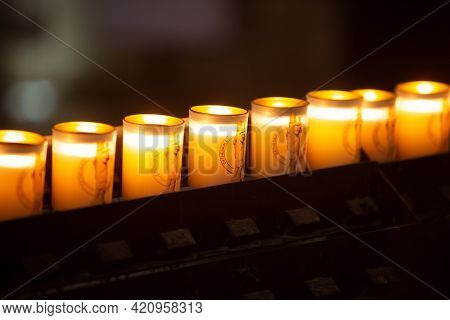 Paris, France, 1.11.2019 - Burning Candles At Notre Dame De Paris Cathedral. Lit Up Row Of Candles W