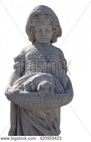 Close up of stone sculpture of girl holding puppies in basket on white background. art and classical style romantic figurative stone sculpture.