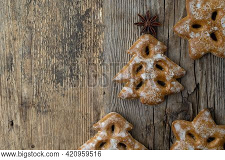 Christmas Tree Cookies On Wooden Background. New Year's Food. Anise Star. Festive Baked Goods. Ginge