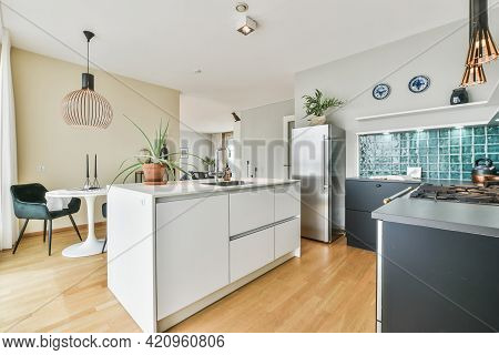Light Kitchen With Minimalist Style Furniture And Decorations At Daytime In Modern Flat