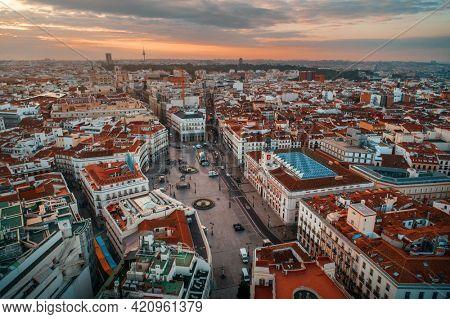 Madrid Puerta del Sol aerial view with historical buildings in Spain.
