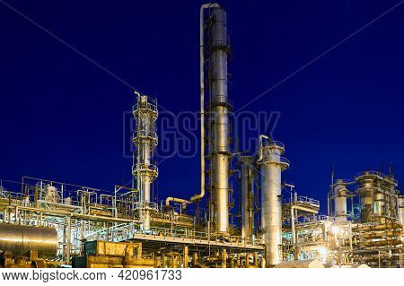 Chemical Plant, Petrochemical Factory At Night. Petro Chemical Power Industry Refinery Enterprise Of