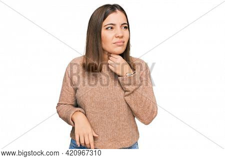 Young beautiful woman wearing casual clothes touching painful neck, sore throat for flu, clod and infection