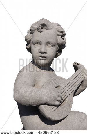 Close up of ancient stone sculpture of naked cherub playing lute on white background. art and classical style romantic figurative stone sculpture.