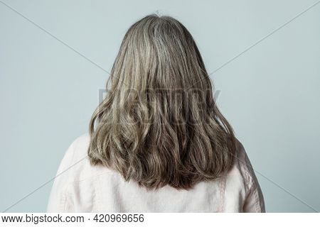 Rear view of a senior woman with gray hair