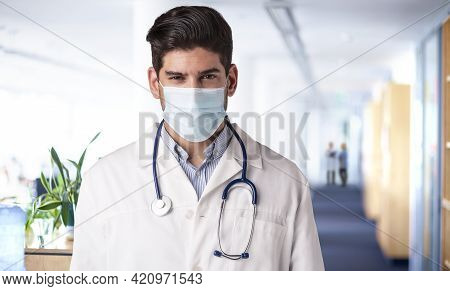 Male Doctor Portrait While Wearing Face Mask On The Hospital's Foyer