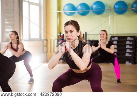 A Group Of Sporting Adult Women Exercising To Strengthen Their Basic Muscles In Fitness Training.