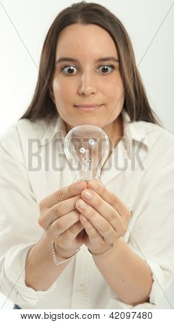 Woman holding a light bulb with a happy expression