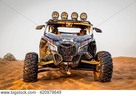 Sharjah, Uae, 16.01.2021. Modern Dune Buggy With Light Bar Front View, Parked On Sand In The Desert,