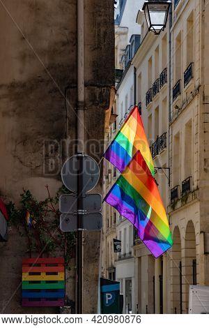 Lgbtq Flags Hanging At Historic Building Corner During Paris Pride. Lgbtqia Culture Symbol. Vintage