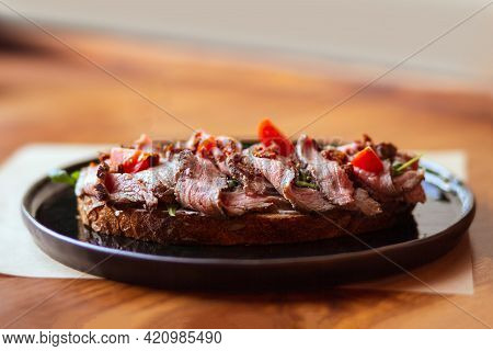 Sandwich With Beef And Tomatoes. Roasted Beef On Toast. Bruschetta With Roast Beef And Cherry Tomato
