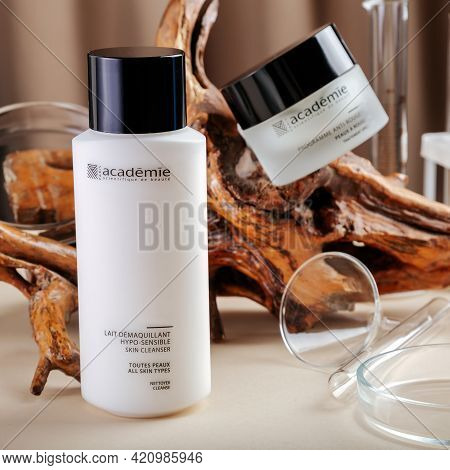 Academie Cream And Cleanser For Skin On Wooden Bark Beige Background With Laboratory Glassware. Edit