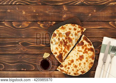 Baked Homemade Flatbread On Wooden Background Close Up
