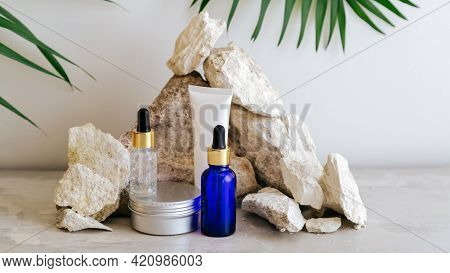 Set Natural Beauty Cosmetic Skincare Products With Palm Leaf Plant On Stone Pedestal, Rock Pile Bala