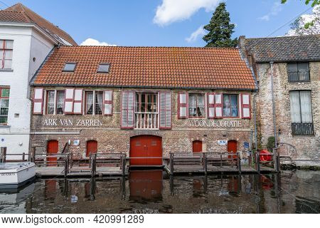 Picturesque Historic Brick Building On The Canals In The Old City Center Of Bruges
