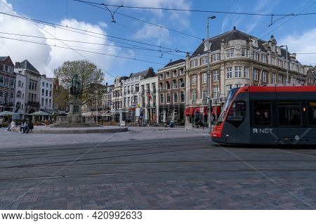 Modern Tram With The Plaats Square In The Background In The City Center Of Downtown Den Haag