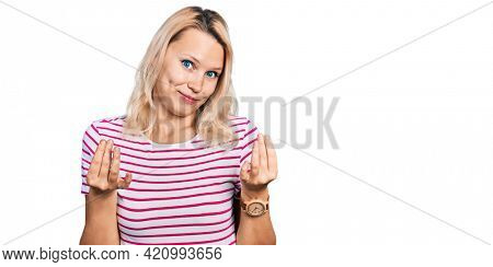 Young caucasian woman wearing casual clothes doing money gesture with hands, asking for salary payment, millionaire business