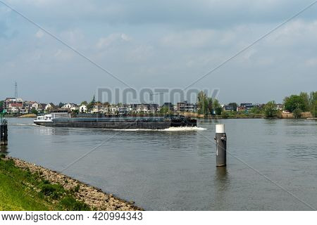 Alblasserdam, Netherlands - 14 May, 2021: River Barge Transporting Goods On The Noord Canal In South