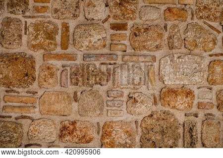 Wall Fragment With Masonry Of Natural Stone Blocks Of Shell Rock Of Different Shapes