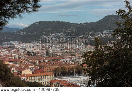 Top View Of The Old French Riviera City With Red Roofs And Mountains On Background. View Of City Of