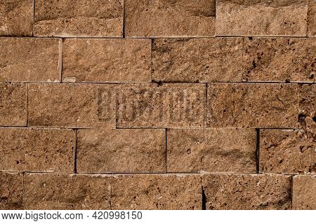Close-up Of Texture Of Masonry Of Brown Square Stone Block.