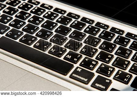 Close-up Detail View Of A Laptop Keyboard On The Keys With High Contrast And Shallow Depth Of Field.
