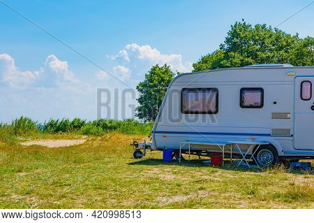 Caravan Trailer Camping On Nature. Travelling, Family Vacation With Mobile Home.