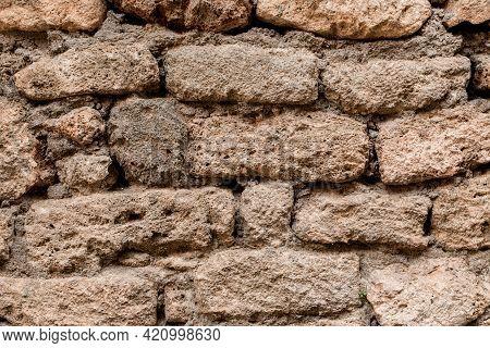 Close-up Of Shell Rock Block Masonry At Wall. Texture Of Natural Stones.