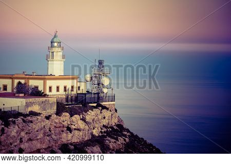Mesa Roldan Lighthouse At Sunset, Cabo De Gata Nijar Natural Park In Almeria Province, Andalusia Spa