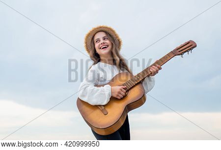 Stylish Child Girl Playing Guitar Outdoor, Vocal