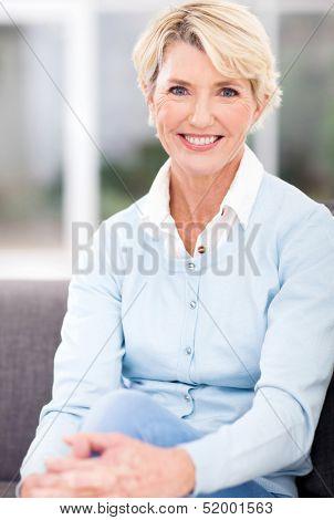 beautiful senior woman sitting at home