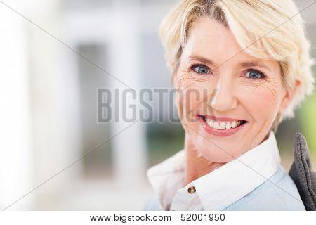 beautiful senior woman closeup portrait at home