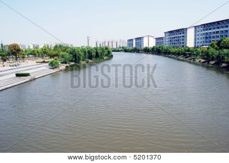river with buildings beside