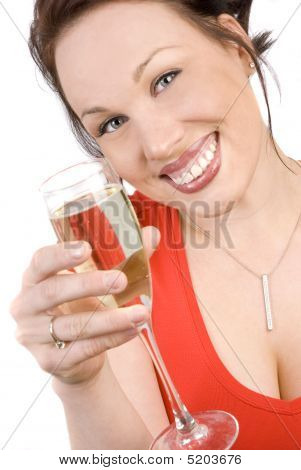 Happy Brunette With A Glass Of Champagne