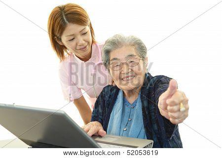 Senior lady enjoys computer