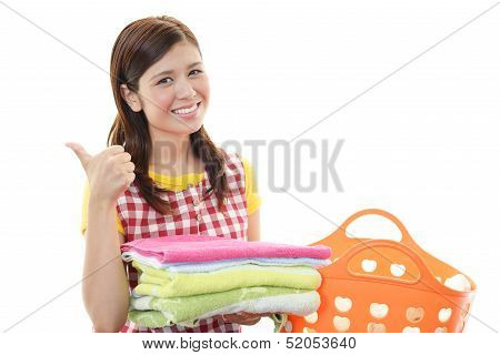Smiling housewife with thumbs up