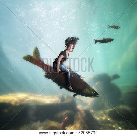 a pretty girl riding a fish