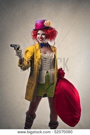 beautiful robber clown with gun and big sack of money