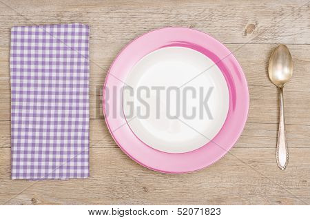 Plate, Spoon, Napkin On A Wooden Table