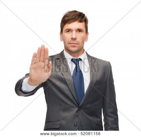 business and office, ban, veto, warning concept - attractive buisnessman making stop gesture