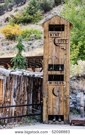 Which would you rather be...the boss or the miner? This two-story outhouse will add a touch of humor anywhere you need it. poster