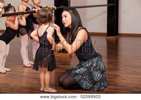 Teacher comforting a dance student