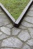 green corner of a garden and stone pavement poster